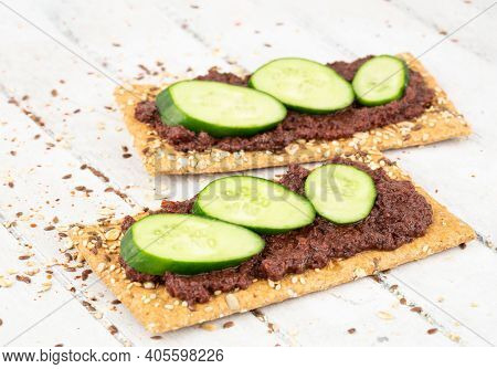 Sandwiches With Olive Paste And Cucumber On Gray Wooden Background.