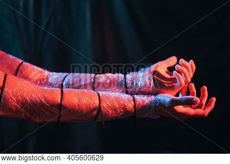 Drug Addiction. Rehab Therapy. Treatment Support. Male Junkie Arms Wrapped In Polyethylene Film Secu