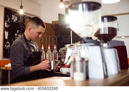 Barista Making Coffee Using A Coffee Machine, Hospitality And Hot Beverage Concept.