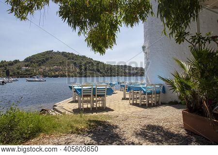 Skiathos, Greece - August 13, 2019. Taverna Tables Looking Over Skiathos Old Harbour, Skiathos Town,