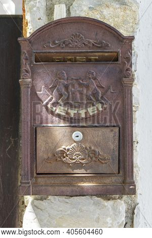 Old And Rusty Letterbox On Traditional House, Skiathos