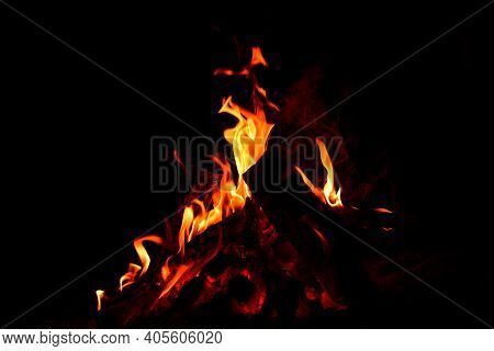 Firewood Burns, Fire Coals At Night. Red Hot Coals Glowing On A Dying Campfire Pit. Orange Glow From