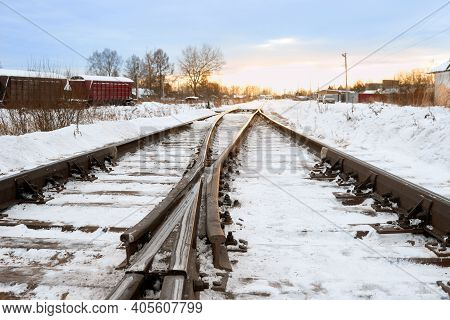 Railroad Tracks At Sunset In Winter Time. Close-up Of Railway Tracks With Crossing. Railway Infrastr