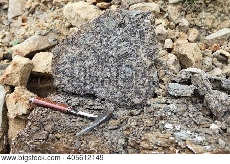 Geologists Hammer On The Phosphorite Rock - Geological Fieldwork. Geologists Hammer, Rock Hammer, Ro