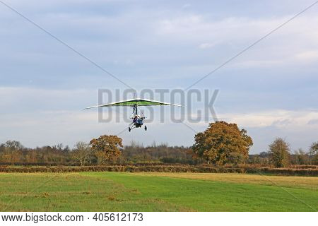Ultralight Airplane Taking Off From A Grass Runway