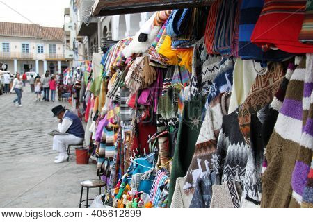 Sale Of Traditional Ecuadorian Clothing At The Cuenca Market . High Quality Photo