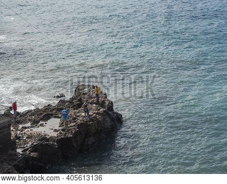 Sardina Del Norte, Grand Canaria, Canary Islands, Spain, December 13, 2020: Group Of Angler Fisherme