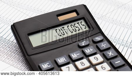 A Calculator With The Word Cut Costs On The Display