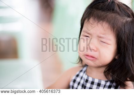 Close Up Of Preschool Cute Asian Child Girl Is Crying. She Had Tears Streaming Down Her Cheeks. Cry