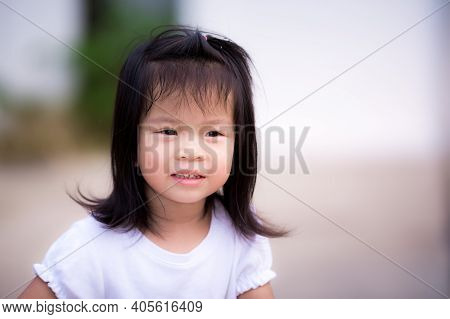 Candid Adorable Asian Little Girl Relaxing Stay At Home During Corona Virus Lock Down. Head Shot Of