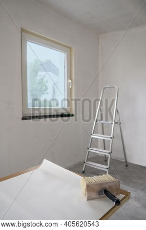 Wide Paint Brush For Glue With Wooden Base For Bristle,sheet Of White Wall Paper Unfolded On Table F