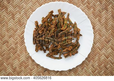 Indian Special Dish Okra Fry With Gramflour Also Known As Kurkuri Bhindi. Served As Starter Snack Wi