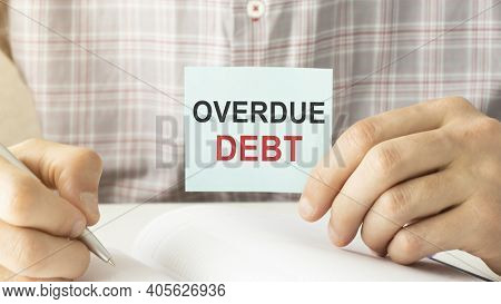 Businessman Hands Hold Card With Overdue Debt Text Business Concept.