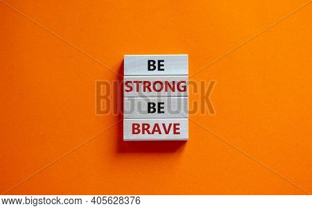 Be Strong Be Brave Symbol. Wooden Blocks With Words 'be Strong Be Brave'. Beautiful Orange Backgroun