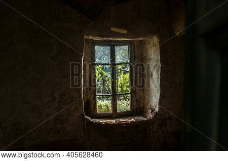 Wooden Window Of Old Abandoned Neglected Country House With View From Inside
