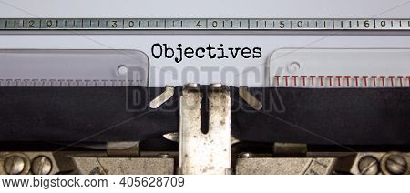 Objectives Symbol. The Word 'objectives' Typed On Retro Typewriter. Beautiful Background. Business A