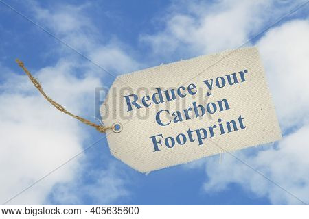 Reduce Your Carbon Footprint Message On Cloth Gift Tag On Blue Sky