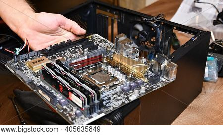 Selective Focus Hands Hold Motherboard Mini-itx With Copper Heat Exchanger Asus And Blurred Ram. Har