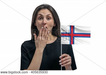 Happy Young White Woman Holding Flag Of Faroe Islands And Covers Her Mouth With Her Hand Isolated On