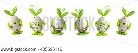Easter Eggs. Happy Easter Card. Multicolored Easter Eggs. Easter. Easter Eggs On A White Wooden Back