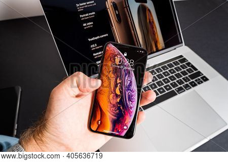 Paris, France - Sep 25, 2018: Pov Male Hand Holding Latest Apple Computers Iphone Max Smartphone Wit