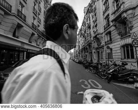 Paris, France - Oct 13, 2018: Silhouette Of Caucasian Male Walking On The Empty Street With Perspect