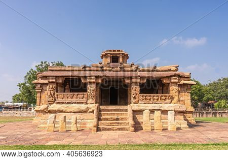 Aihole, Karnataka, India - November 7, 2013: Lad Khan Temple Under Blue Sky. Brown Stone Building Wi