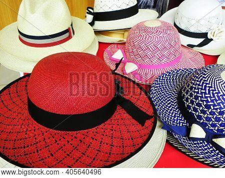 Colorful Handmade Panama Hats Or Paja Toquilla Hats Or Sombreros At The Traditional Outdoor Market I