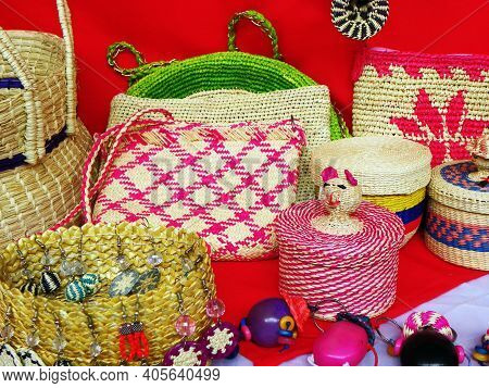 Cuenca, Ecuador - January 29, 2021: Wicker Souvenirs: Baskets, Dolls, Toys, Earrings Made From Toqui