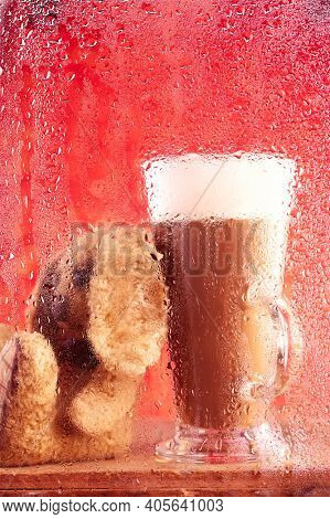 bunny and coffee latte behind rainy window, shallow dof on glass with droplets