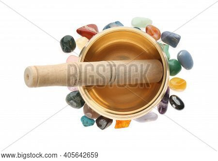 Golden Singing Bowl With Mallet And Healing Stones On White Background, Top View
