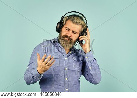 Hipster Enjoy Excellent Sound Song In Earphones. Popular Music Playlist. Singer On Rehearsal. Music