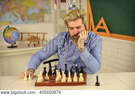 Thinking Of Next Move. Bearded Man Training For Chess Competition. Chess Figures On Wooden Board. Fo