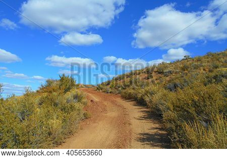 Plodding Up The Plot - The Road Going To The Top Of Plot Butte - South Of Millican, Or