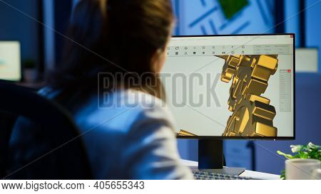 Focused Woman Architect Working At New Project Using Computer Doing Overtime At Night Sitting At Des