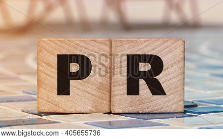 Pr Word On Wood Blocks On Relaxed Beach Background. Luxury Life Concept. Public Relation Marketing B