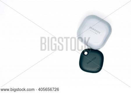 Kiev, Ukraine - January 29, 2021: Tracker Smarttag With Headphones Samsung Buds Pro On White Backgro