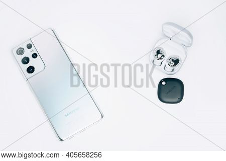 Kiev, Ukraine - January 29, 2021: New Devices From Samsung. A Phone Galaxy S21 Ultra, Headphones Bud