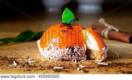 Orange Mousse Cake. French Vanilla Mousse Cake With Tangerine Mirror Glaze For Dessert. Portion Mode