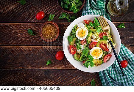 Fresh Avocado Salad With Tomato, Avocado, Boiled Eggs And Fresh Lettuce. Ketogenic Diet Breakfast.