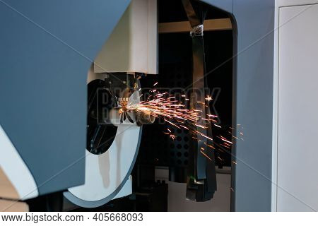 Automatic Cnc Laser Cutting Machine Working With Cylindrical Metal Workpiece With Sparks At Factory,