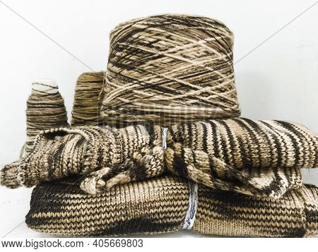 Yarn In Coils And Knitted Products From This Yarn In Production.