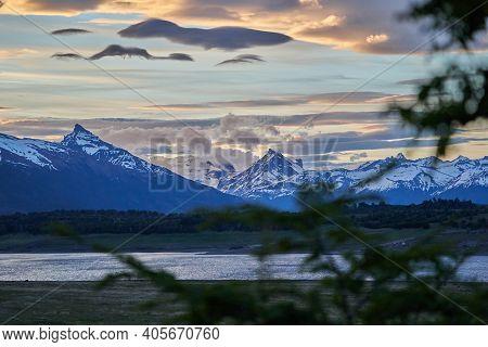 Moody Sunset With Dramatic Clouds Over The Landscape Of Lago Roca At Perito Moreno Glacier In Glacie