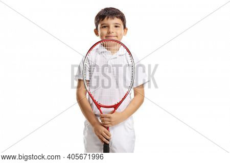 Boy holding a tennis racquet and looking at the camera isolated on white background