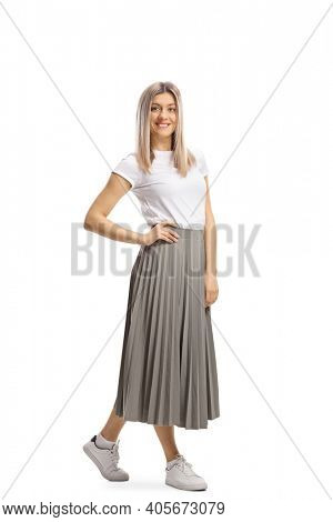 Full length portrait of a casual blond woman in a pleated skirt and white t-shirt isolated on white background