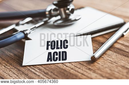 Folic Acid Text Written On Card On Wooden Table With Medical Background.