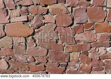 Granite Wall Texture. The Fence Is Made Of Granite Stone.