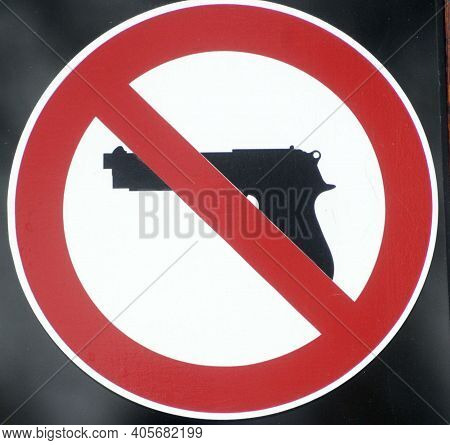 A Prohibition Of Firearms Sign, Red Circle And Weapon Pictogram