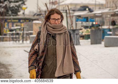 Prague, Czech Republic. 01-29-2021. Portrait Of A Woman Walking In The Center Of Prague During A Sun