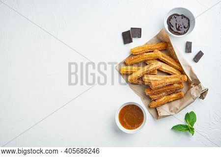 Churros With Chocolate, Traditional Spanish Cusine, On White Background, Top View Flat Lay With Spac